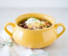 Slow Cooker Chicken Chili recipe - a delicious change to the traditional chili that will keep everyone coming back for seconds.