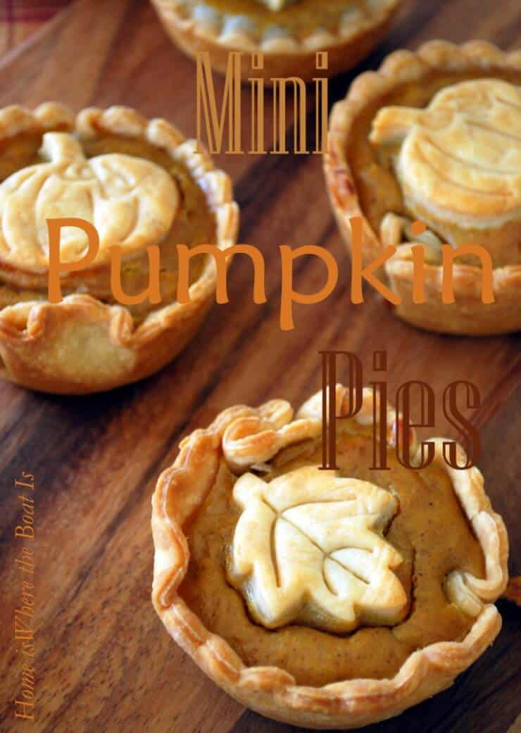 mini pumpkin pies on wood table