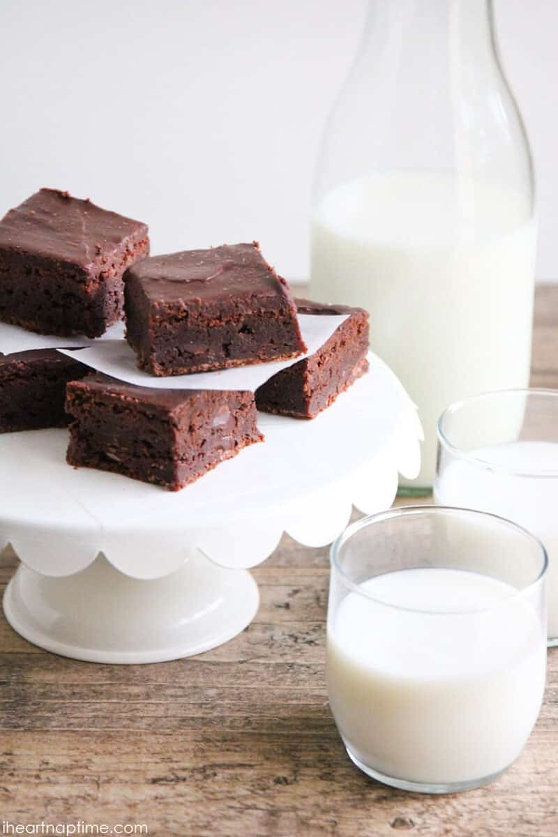The Ultimate Fudge Brownie Recipe - fudge-y brownies, studded with chocolate chips and topped with a smooth, luscious ganache.