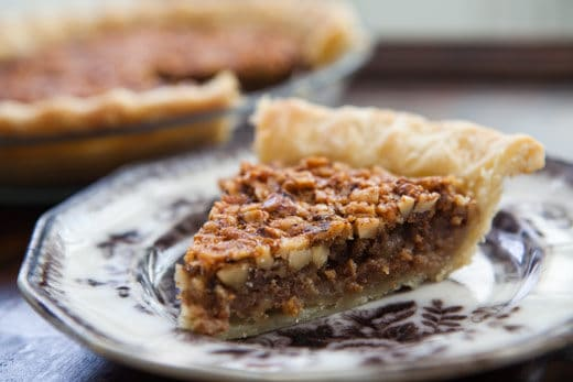 slice of walnut maple pie on plate