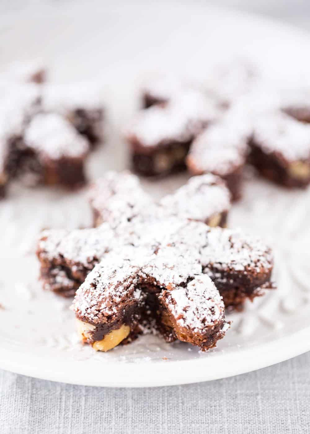 ROLO Snowflake Brownies - chewy, fudgey brownies filled with chocolate, caramel, and nuts! The perfect holiday dessert!