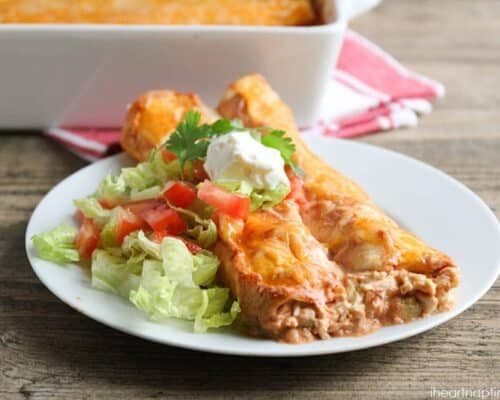 Creamy chicken enchiladas - my favorite meal! Warm, gooey, and oh-so-delicious! A comforting dinner for chilly nights!