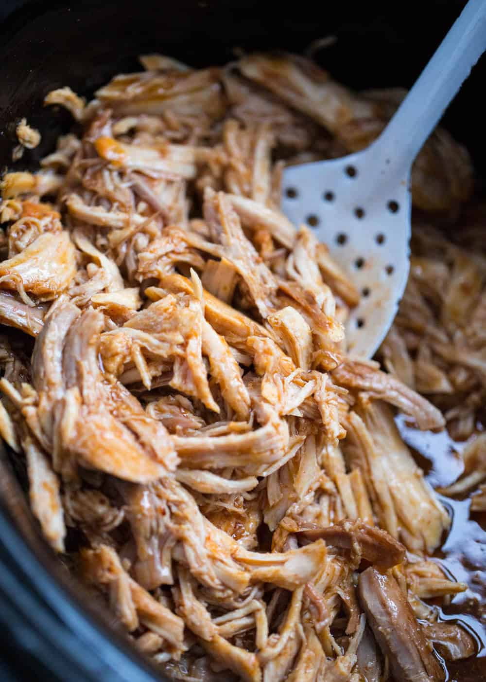 Slow Cooker Sweet Pork - made with 5 ingredients and only takes 5 minutes of prep work! Tastes great in tacos, burritos, salads and enchiladas! This recipe is SO super simple to make and full of flavor!