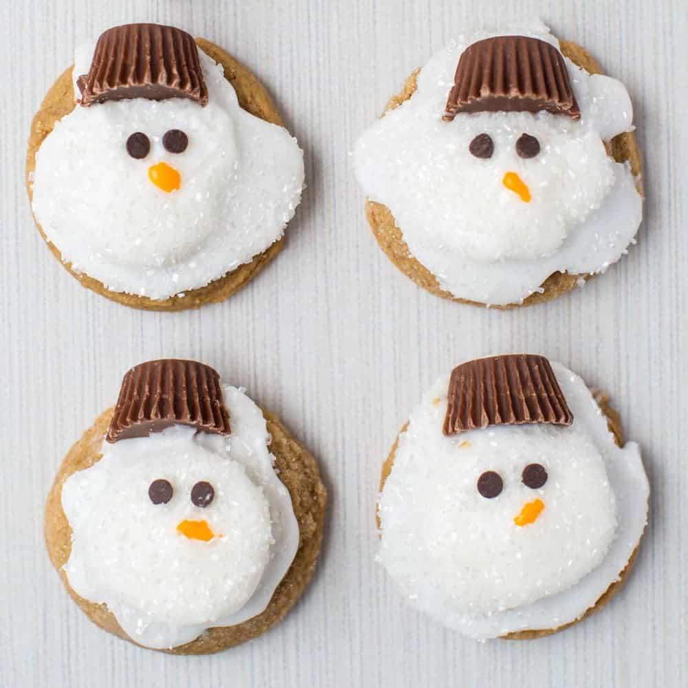 four snowman cookies