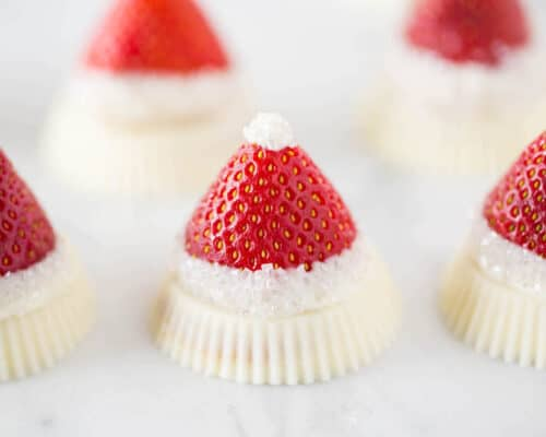 White Chocolate Strawberry Santa Hats with a Reese's base - so cute and tasty!