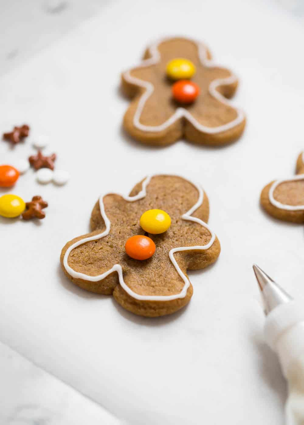 Adorable homemade gingerbread men with Reese's pieces for the buttons