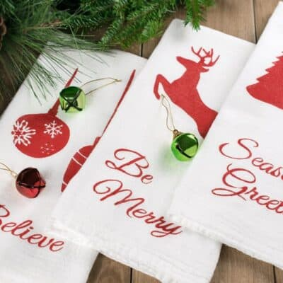 Christmas Stenciled Kitchen Towels - the perfect DIY to bring some holiday cheer into your kitchen!