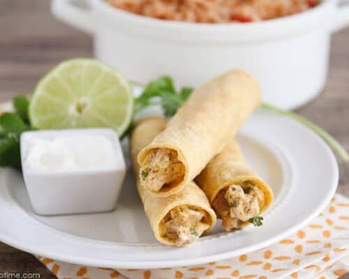 Creamy Chicken Taquitos - an easy and delicious crock pot meal teaming a creamy, delectable chicken mixture with Tex Mex spices. A perfect dinner for busy weeknights!