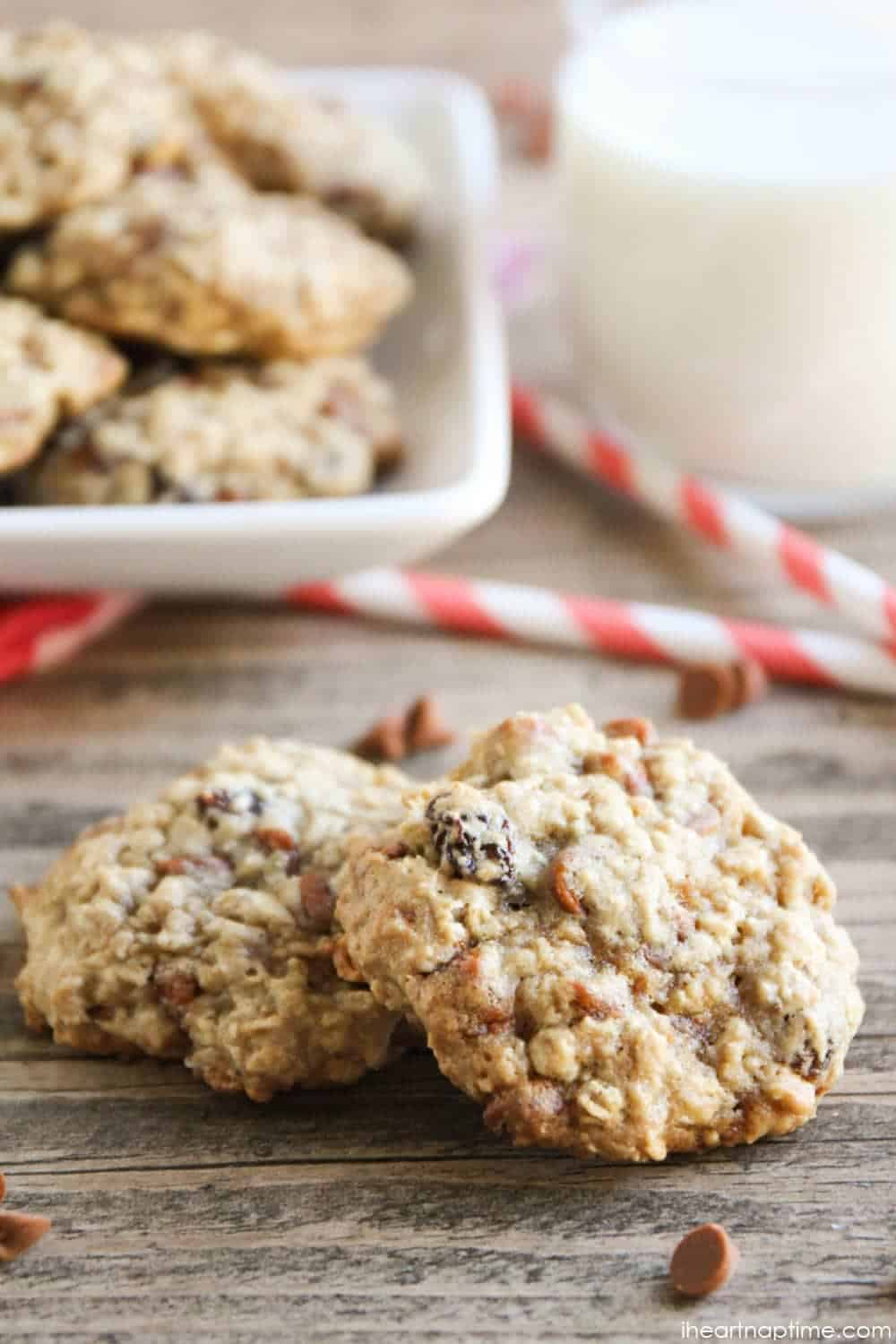 Oatmeal Raisin Cookies with Cinnamon Chips - these cookies are seriously divine! The cinnamon chips add the perfect touch to the classic oatmeal cookie.