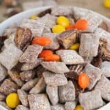 Reese's Muddy Buddies - a fun twist on the classic favorite with the addition of Reese's Peanut Butter Cups and Reese's Pieces! Such an easy treat that is loved by kids and adults!