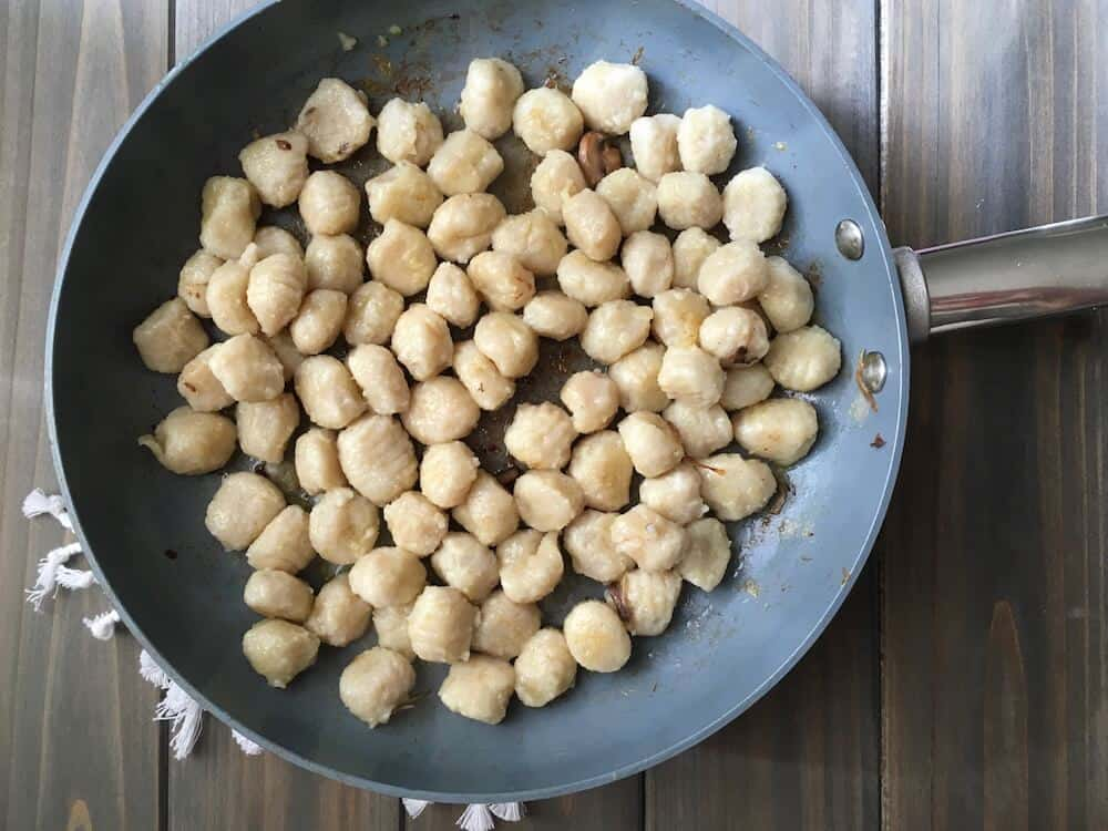 Easy Parmesan Mushroom Gnocchi - A family pleaser and comforting for a chilly winter night. It's simple to put together with store-bought helpers like sliced mushrooms and packaged gnocchi, but tastes like date night out.