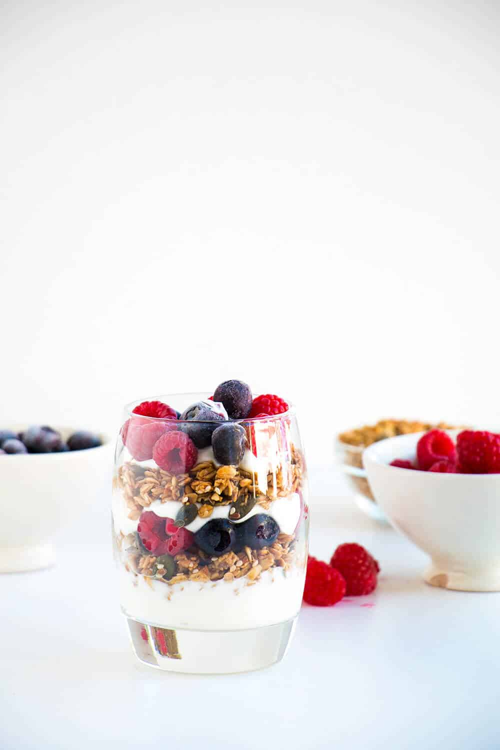 parfait with yogurt, berries and granola on the counter