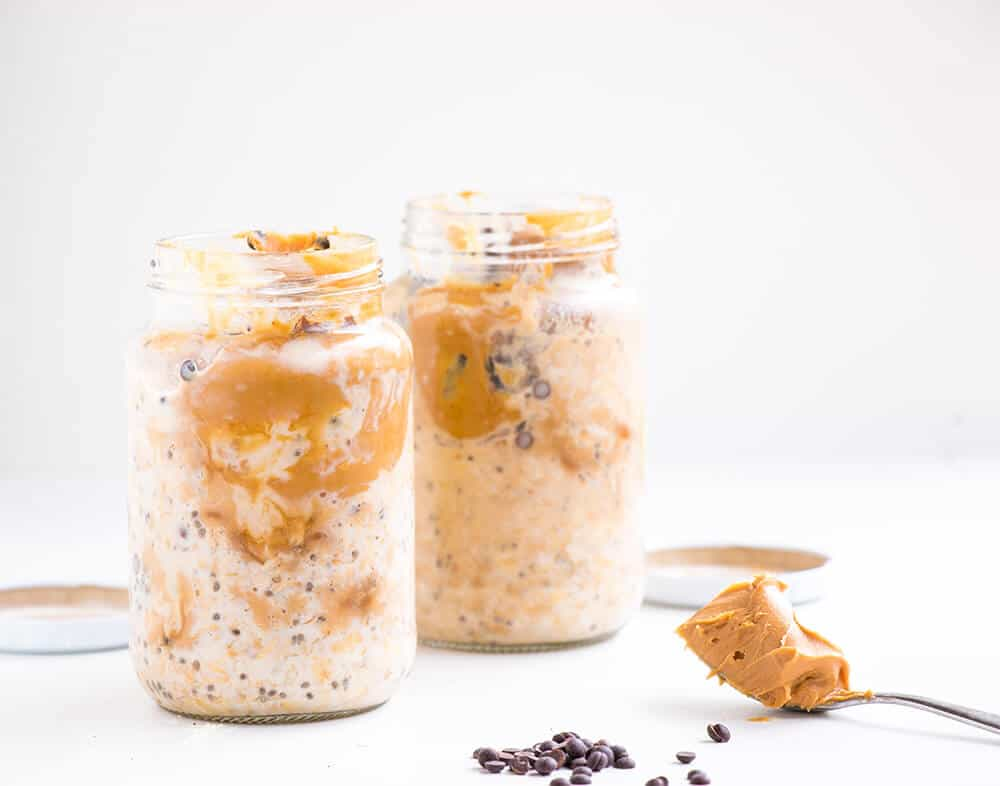 two mason jars filled with peanut butter overnight oats