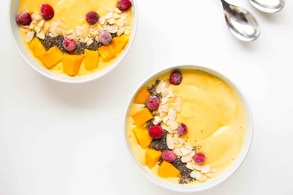 Easy Mango Smoothie Bowl - A refreshing and healthy breakfast option that will make you feel as if you're on a tropical island.