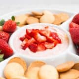 Strawberry Cheesecake Dip Recipe - a sweet and creamy dip that takes minutes to whip up. This dip tastes great served with strawberries, graham crackers or cookies.