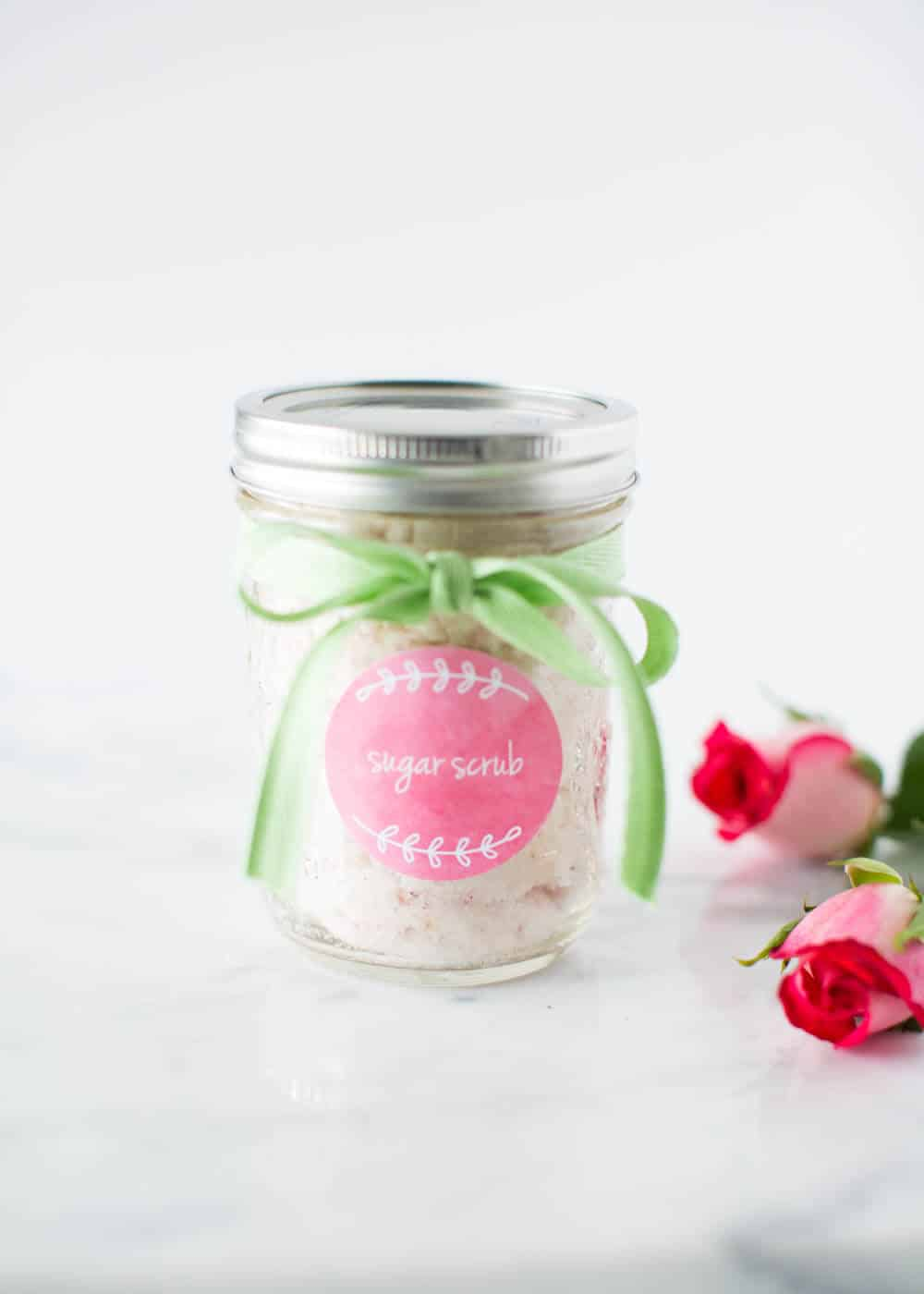 Vanilla sugar scrub in a mason jar with green ribbon