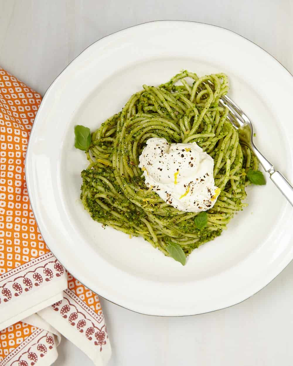 Winter Pesto Spaghetti With Lemon Ricotta - the perfect way to get a fresh taste of summer using winter ingredients during colder months. Citrus, like lemons, add a bright freshness to a sweet and savory cream topping.