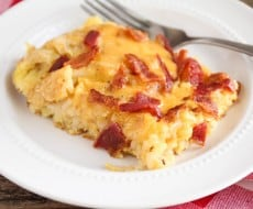 Cheesy Bacon Breakfast Skillet - easy to put together, but tastes indulgent and oh-so-delicious. Perfect for the holidays, breakfast for dinner, or anytime you want to put a smile on your family's faces!