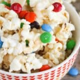 caramel corn with chocolates in bowl