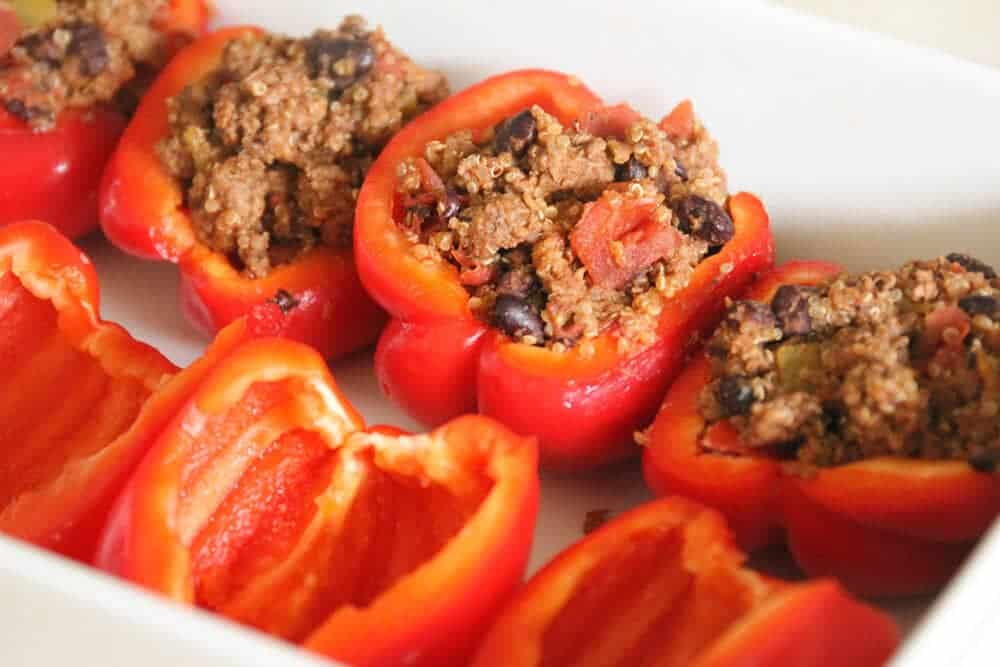 adding filling to bell pepper halves
