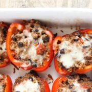 Stuffed Bell Peppers with Quinoa - a delicious, healthy, and quick meal my whole family enjoyed (I was pleasantly surprised that the kids ate these happily and quickly!)
