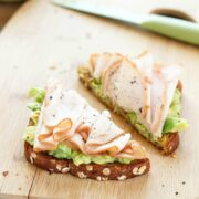 turkey and avocado toast on table