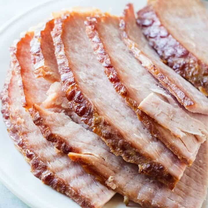 spiral ham slices on a white plate