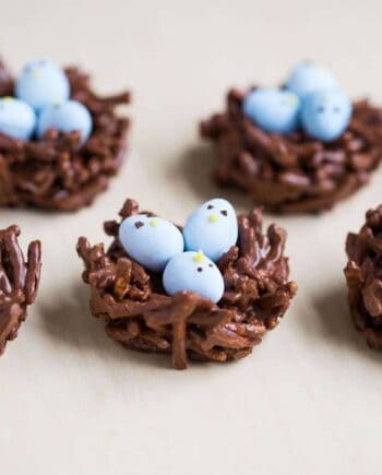 Chocolate Egg Nest Treats - made with chocolate, butterscotch and mini Cadbury eggs. An adorable treat for Easter and Spring! These are no-bake and this recipe only take minutes to make!