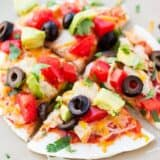 mexican pizza cut into slices