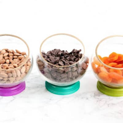 DIY Snack Bowls - Create a DIY healthy snacking station by making colorful snack bowls filled with tasty ingredients! Simple pieces of wood and glass combine to create a colorful and unique snack station that elevates snack time.