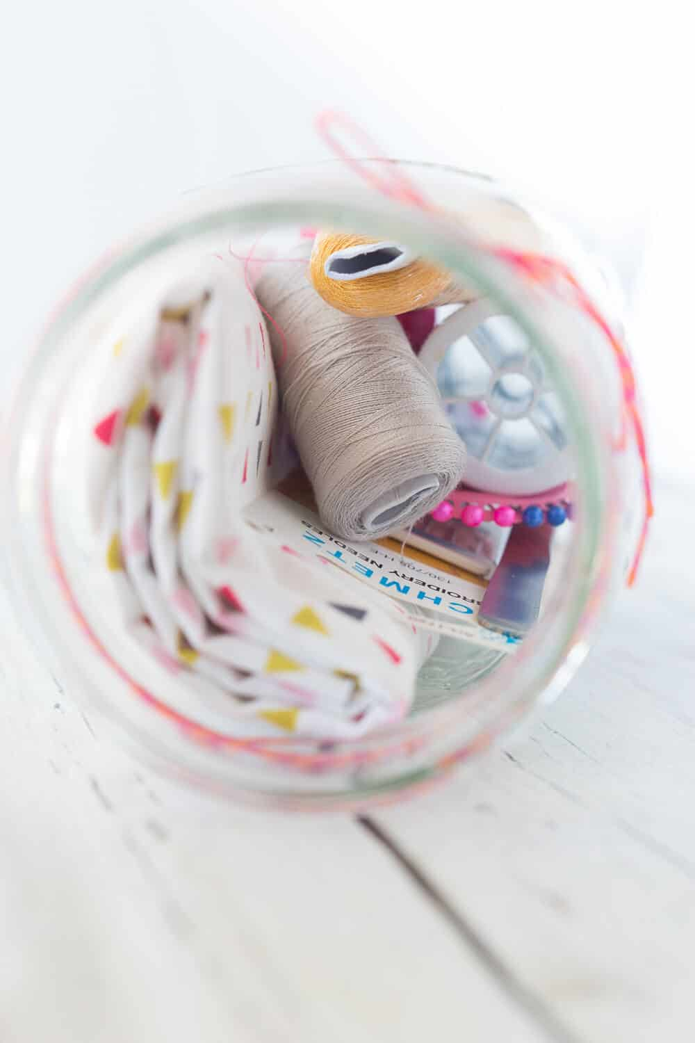 Mason Jar Sewing Kit Gift - this is a perfect gift for the seamstress in your life. Filled with sewing notions, pretty fabric and more!