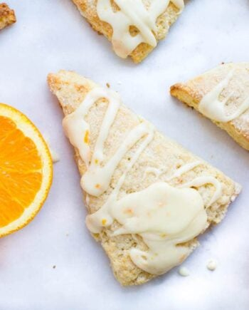 Glazed orange scones recipe... sweet and soft bakery-style scones topped with a fresh orange juice glaze.