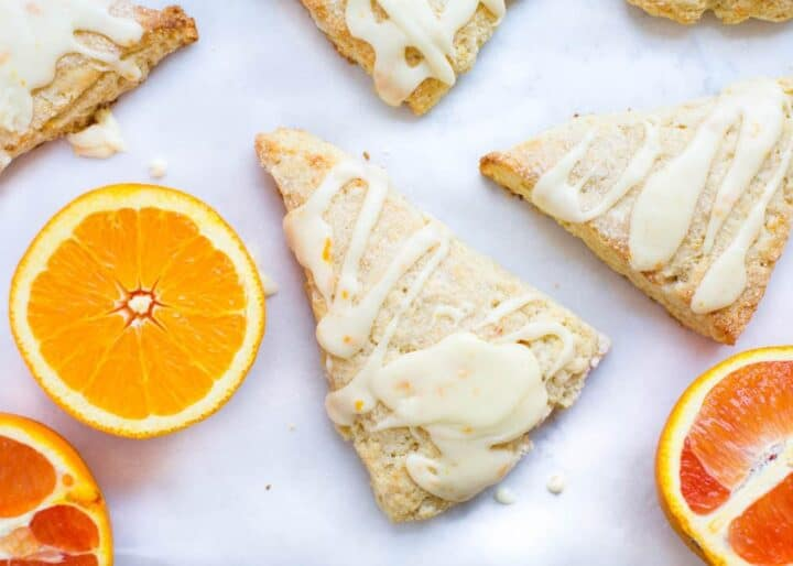 orange scones drizzled with glaze on top