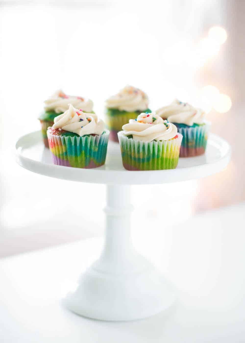 rainbow cupcakes on cake stand