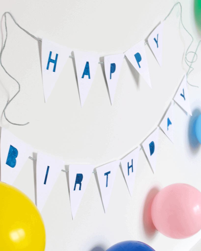 Recycled Balloon Birthday Banner - makes the most of your last party, while preparing for the next one! We make it even easier with a free printable!