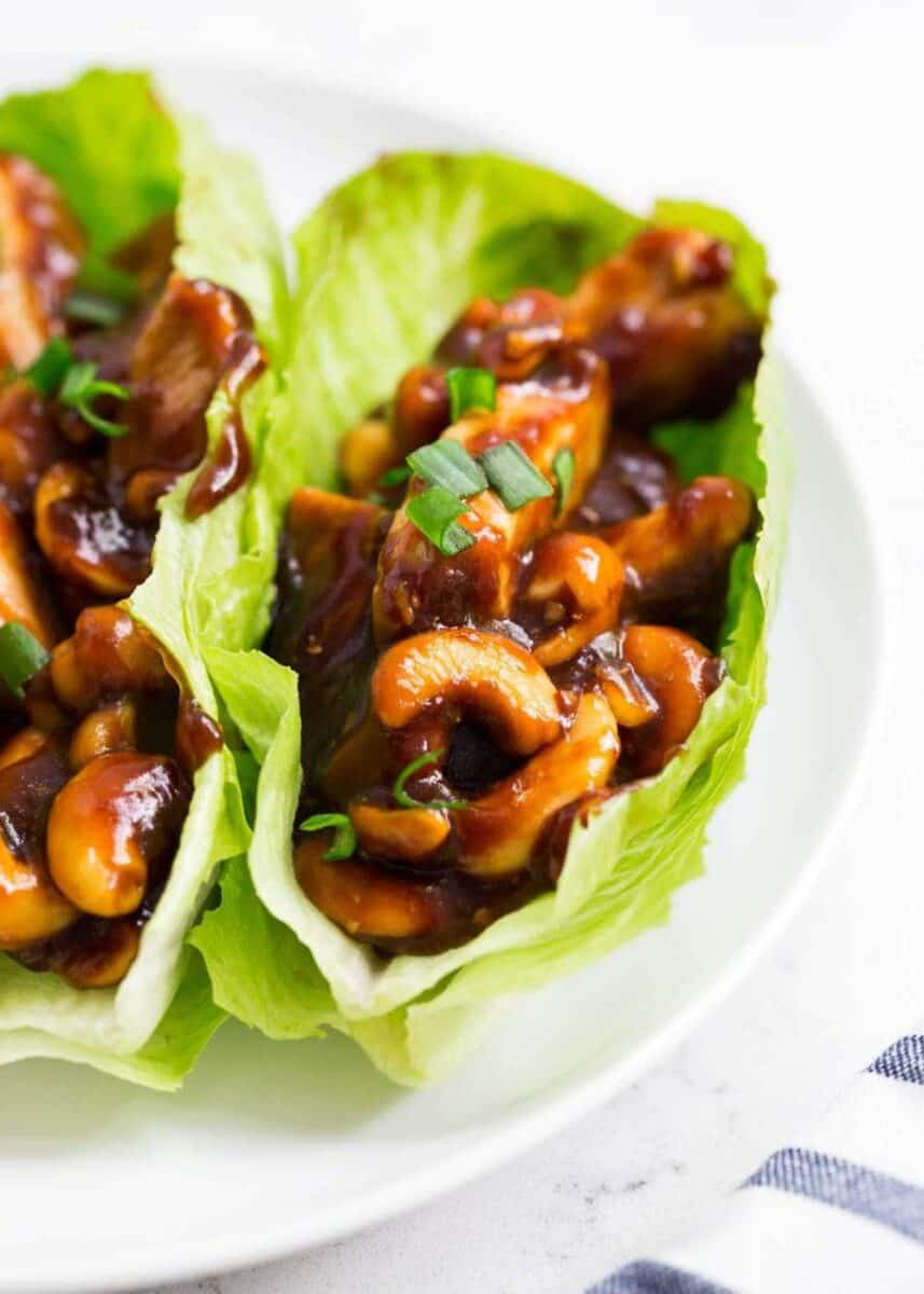 close up of cashew chicken in lettuce wraps