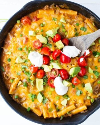 This ONE POT cheesy enchilada pasta recipe is so simple and completely delicious. It's done in 30 minutes from start to finish and is a family favorite!