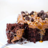 piece of chocolate turtle poke cake on a plate