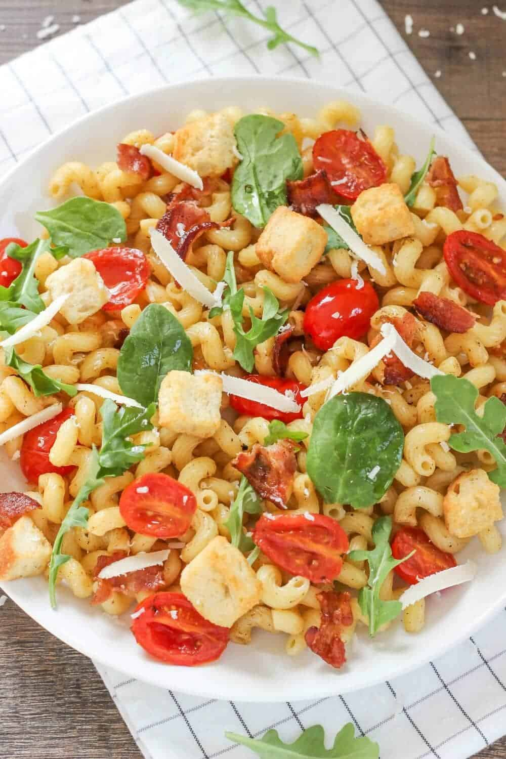 blt pasta salad recipe on a white plate