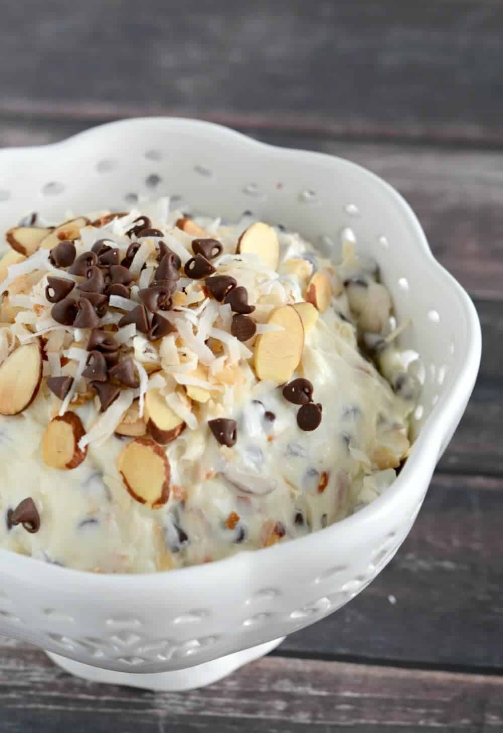 Almond Joy Dip . . . this yummy dip is ready in just minutes, and tastes fabulous with fruit, crackers, or pretzels. Such a yummy snack!