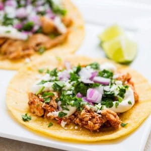 Slow Cooker Chicken Tinga Tacos - 5 minutes to prep and it tastes like it came from a Mexican restaurant!