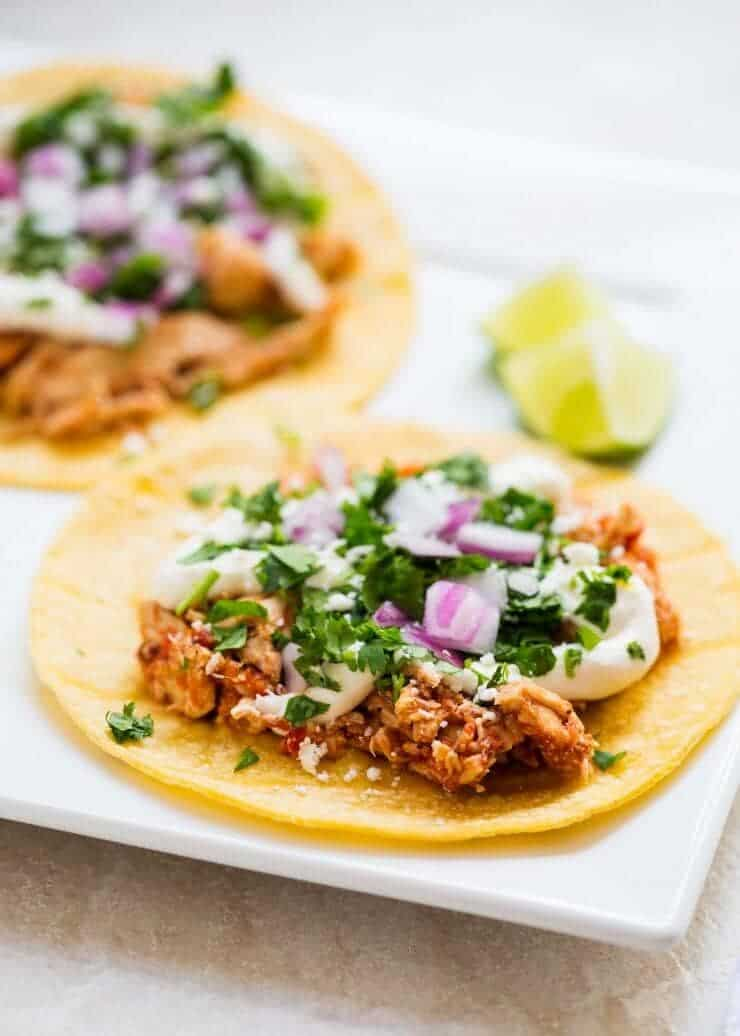 Slow Cooker Chicken Tinga Tacos, a recipe that tastes like it came straight from a Mexican restaurant. The best part? It only takes 5 minutes to prep!