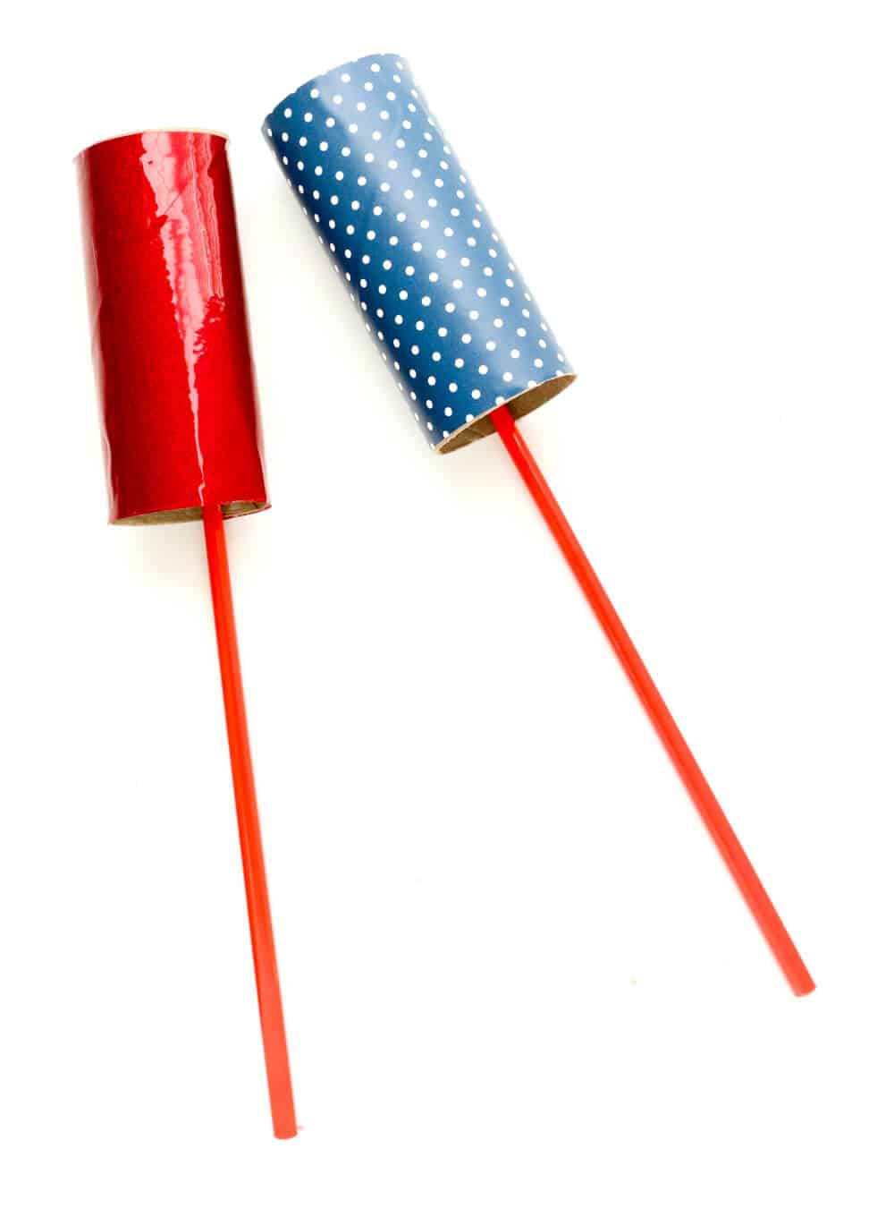 DIY Firework Ribbon Wands - taping together, the little ones love to help!