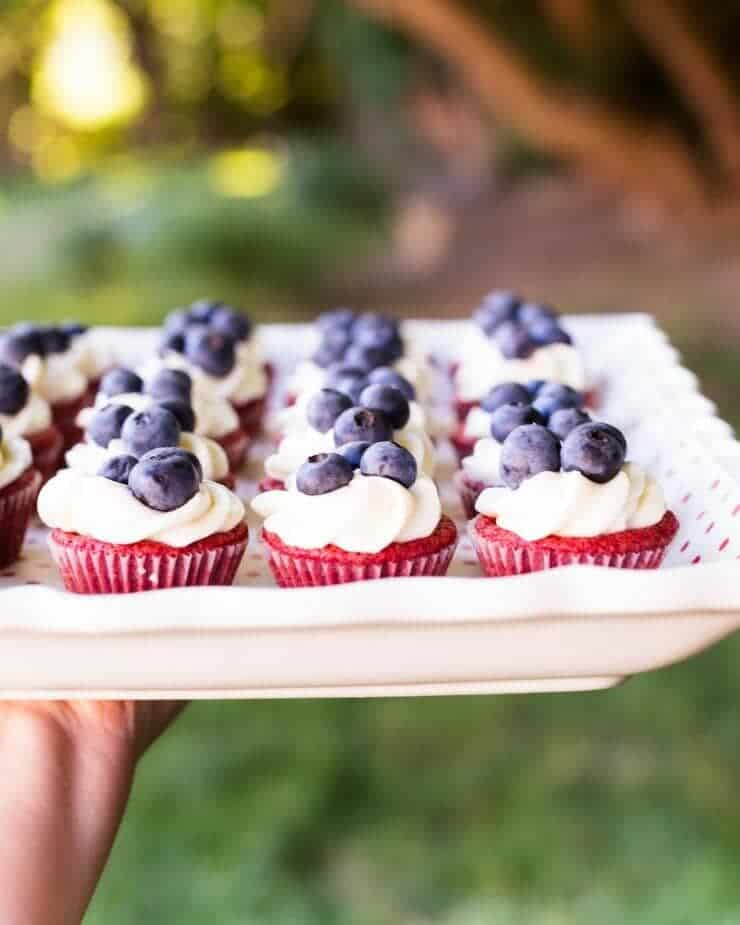Red Velvet Brownie Cups with Cream Cheese Frosting - these mini cupcakes are easy to transport to your next get together!