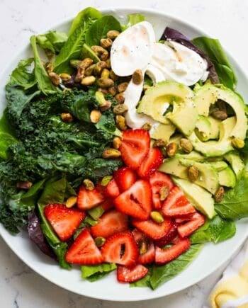 strawberry burrata salad on a white plate