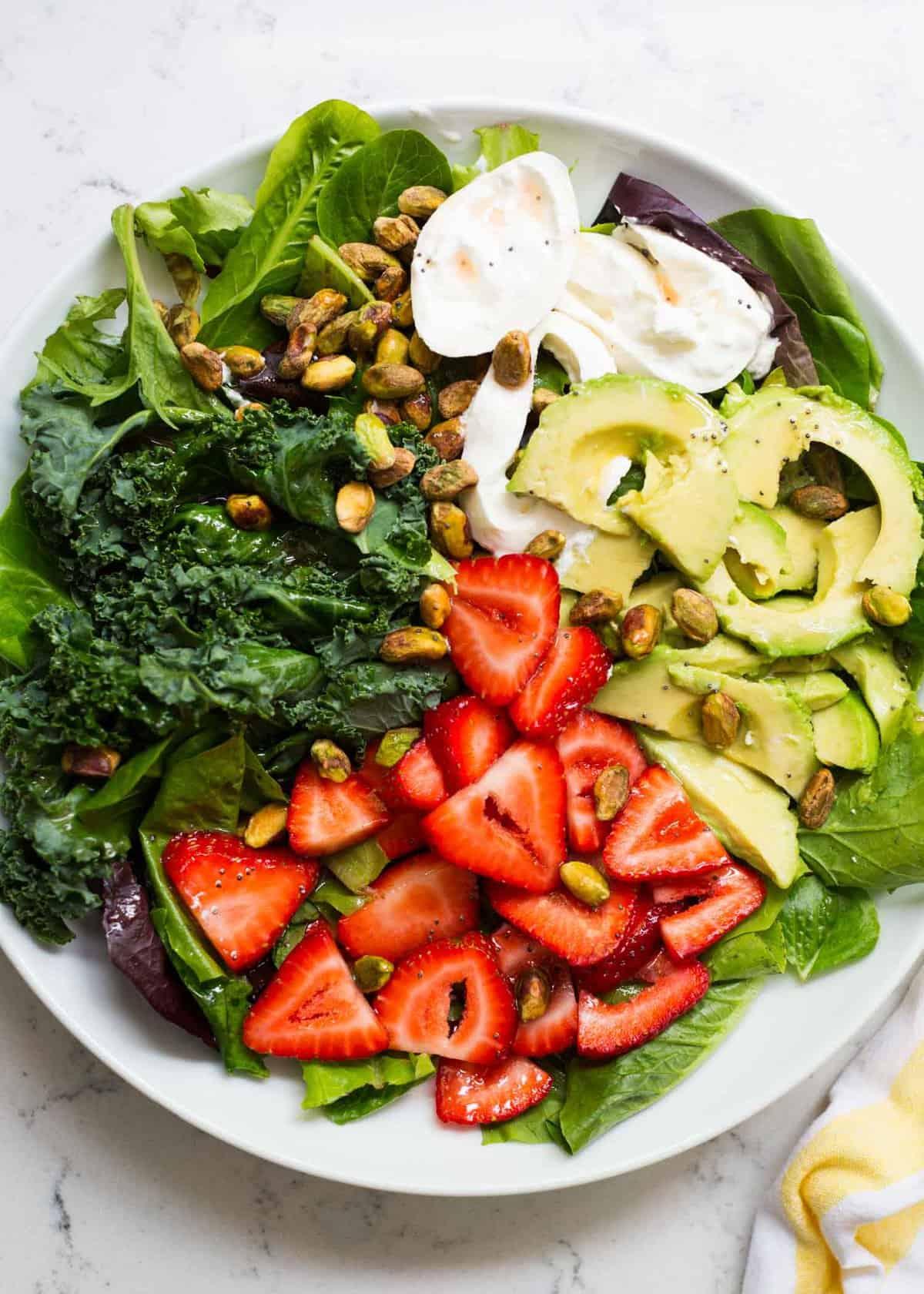 strawberry burrata salad on white plate