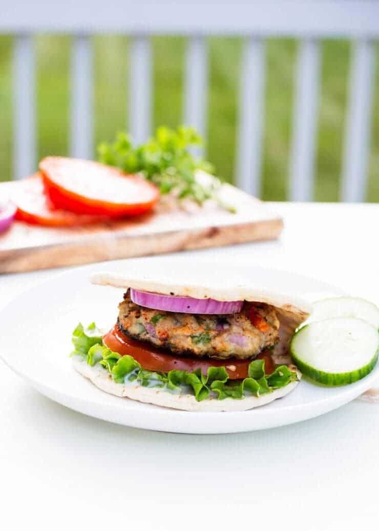 Greek style chicken burger... light on calories without sacrificing flavor! Find the recipe on iheartnaptime.net