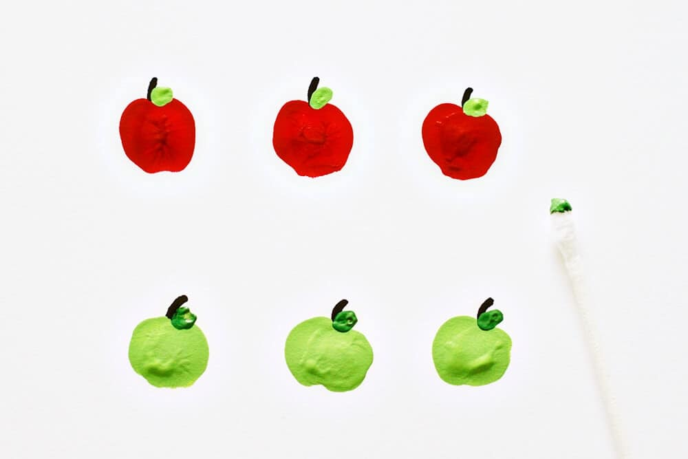 Apple Fingerpaint Bowls... adding leaves to the apples