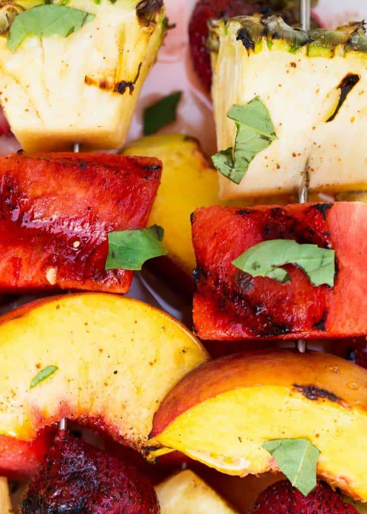Grilled Fruit Kabobs with a Cinnamon Honey Glaze... easy to make, and so delicious! We love to put these on the grill anytime we're enjoying dinner outside.