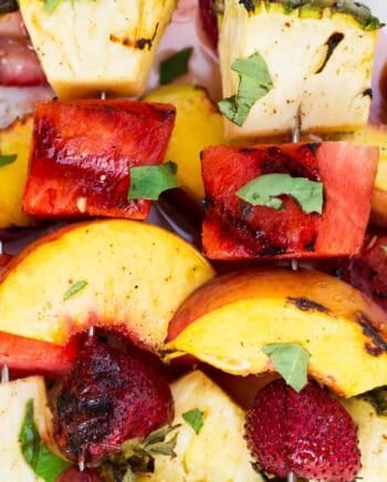 close up of grilled fruit kabobs